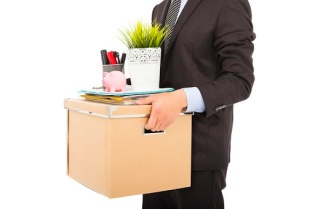 26538766 - fired businessman carrying his belongings
